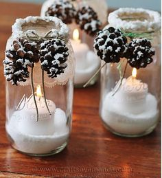 Maybe it would look better with a shorter glass. You could use battery powered candles too. Creative Pinecone Crafts for Your Holiday Decorations --> Snowy Pinecone Candle Jars Christmas Mason Jars, Noel Christmas, Rustic Christmas, Christmas Projects, Holiday Crafts, Handmade Christmas, Christmas 2017, Christmas Candles, Christmas Ideas