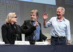 """Harrison Ford Carrie Fisher Photos Photos - (L-R) Actors Carrie Fisher, Mark Hamill and Harrison Ford at the Hall H Panel for """"Star Wars: The Force Awakens"""" during Comic-Con International 2015 at the San Diego Convention Center on July 10, 2015 in San Diego, California. - Star Wars: The Force Awakens Panel at San Diego Comic Con - Comic-Con International 2015"""