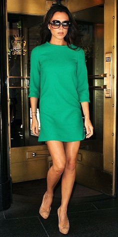 Victoria Beckham left her N.Y.C. hotel in a kelly green Goat shift and cork platform pumps.
