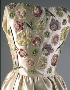 detail from Jackie Kennedy Ivory Embroidered Evening Dress by Hubert de Givenchy