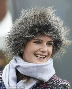 Bucking the trend for fascinators, a racegoer wore an unusual fur hat to the Liverpool course