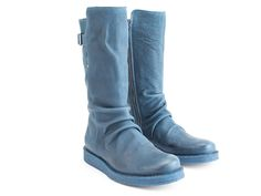 """Named after a highway with picturesque views, The Sea to Sky is perfect pair of boots to getaway in. Built in crinkles give them a lived-in look while a high tongue and elasticized strap with buckle make for some beautifully flattering angles. Crafted from soft nubuck leathers, they feature an inside zip and wonderfully friendly 1"""" crepe soles with an EVA insert.Driven to do it!Made in Portugal Soft nubuck leathers Metal buckle Natural crepe wedge soles with an EVA foam insert"""