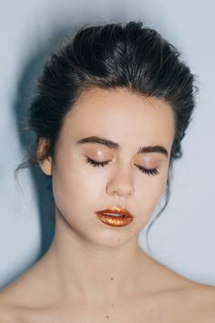 FASHION PHOTOGRAPHY Beauty editorial. Winter party glitter make up. Dark hair up do. New Year inspiration.