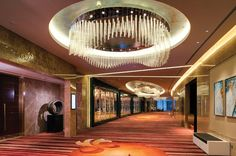 The rain shower motif of the hotel's lobby is carried over into other areas of the hotel; here custom chandeliers are positioned outside the hotel's Grand Ballroom.