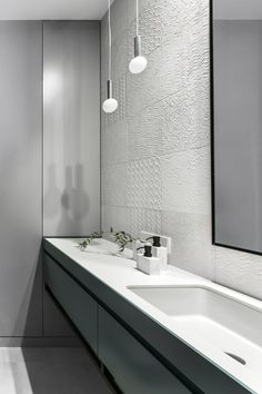 AKTA designed a refined and decorative interior. Monochrome background enhances rich colours and allows the artworks to stand out. Cold grey tones are balanced by velvet fabrics which also make a contrast to the textured ceiling. #tiles #bathroom