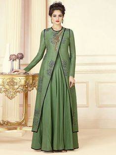dee7e7c683 Enchanting green wedding gown online which is crafted from tussar silk  fabric with exclusive embroidery also