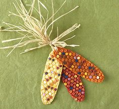 Bubble Wrap Indian Corn.  Paint long ovals of bubble wrap on the back with the base color.  When dry, flip over the corn cobs, and use q-tips to paint the individual niblets random colors.  Mount onto cardstock backings, tie on some raffia, and you have a cute little decoration.
