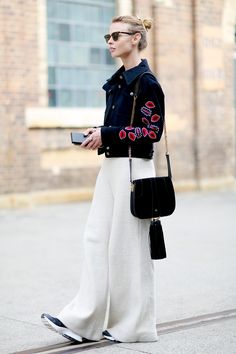 White wide leg trousers, lips jacket and black satchel bag with top knot hair // street style