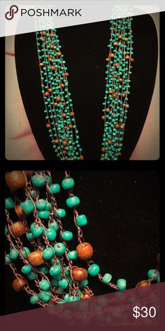 Turquoise and wood beads hand tied necklace Very real looking turquoise beads with wood beads as accents. Hand knotted brown thread makes up the chain.  Can be twisted to choker length or left as a multi strand necklace. Never even wore this one.  NWOT Jewelry Necklaces