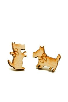 """Laser cut birch scottie dog friends on surgical steel posts. We love that the two pieces in this set are different but still very similar! Each measure approximately 1"""" x 1/2"""". Made in USA."""