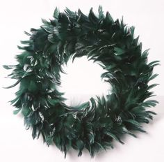Zucker Feather Products Goose Coquille Wreath, 15-Inch Diameter by Zucker Feather Products. $19.55. 15-Inch Diameter. Hunter Green with Opalescent Tips. Great accessory piece. Goose Coquille wreath dyed hunter green with opalescent glitter on tips of feathers. Wreath is 15 inch diameter. Feathers have been added to a Styrofoam form which makes the wreath a great center piece as well.. Save 22%!