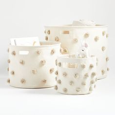 Shop Pehr Pom Pom Drum Bins. Designed for versatility and convenience (not to mention playfulness), this storage bin features a space-saving, collapsible design. It's made from 100% cotton and adorned with an array of gloriously fun handmade pom poms.
