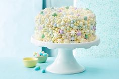 Magic Frosted Carrot Cake—Speckled with chocolate eggs and whimsical dots of Magic Frosting, our best and prettiest carrot cake sweetens up Easter in the most delightful way. Round Cake Pans, Round Cakes, Mini Eggs, Salty Cake, Chocolate Decorations, Cake Mold, Savoury Cake, Mini Cakes, Carrot Cake