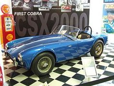 Shelby AC Cobra, CSX2000. In September 1961, American automotive designerCarroll Shelbywrote to AC asking if they would build him a car modified to accept a V8 engine. AC agreed, provided a suitable engine could be found. Shelby went to Chevrolet to see if they would provide him with engines, but not wanting to add competition to the Corvette they said no. However,Fordwanted a car that could compete with the Corvette