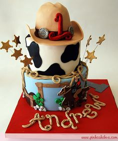 Cowboy Themed Birthday Cake by Pink Cake Box in Denville, NJ.  More photos and videos at http://blog.pinkcakebox.com/cowboy-themed-birthday-cake-2010-10-28.htm