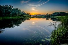 Golden hour glow on a river... by Aleksei Malygin