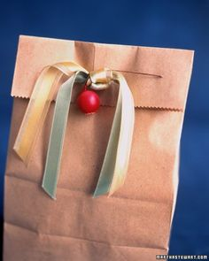 Transform ordinary brown or white paper bags into elegant wrappings with simple ribbon and button embellishments.Martha Stewart Living, 1995/1996
