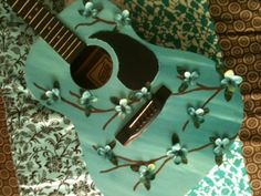 """I call this guitar """"Ashes to Beauty"""". I have a huge thing for anything with blossoms!"""