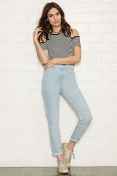 A classic pair of mom jeans with a high-waisted fit, slightly tapered legs, a zip fly, and a five-pocket construction.