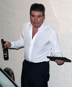 Feeling silly: The new dad pulled faces for the cameras, feeling happy that all of his act.BAN THE BOOZE? Simon Cowell, New Dads, Cheryl, Factors, Chef Jackets, Coat, Feeling Happy, Cameras, Fashion