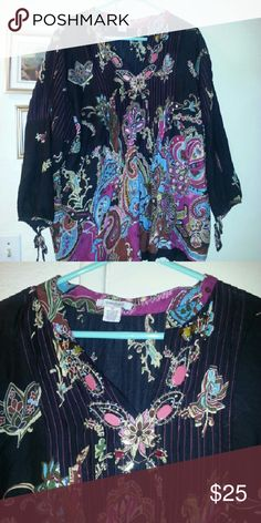 Cotton boho top Black boho style top with great print and colors. Beading at v neckline. Pin tucks down front. Sleeves are 3/4 with ties at bottom. Size says 2x, but I'm going to list as a 1x. Would work well as a cover up for a size medium or large.  Black background with turquoise pinks golds some browns and greens too. Dress Barn Tops