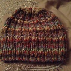 This fitted hat knit in a soft and cozy alpaca will keep you or your loved one toasty warm while raking the leaves, or heading out on a winter hike.