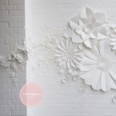 white paper flower photo backdrop on white brick wall! Perfect for weddings