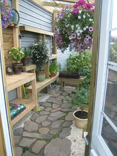 Love this greenhouse floor, a combination of flagstone and gravel