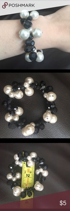 Black and white chunky beaded bracelet Large plastic white beads that resemble pearls are interlaced with faceted, smaller black beads. Stretchy. Fun and funky, yet classic colors. Worthington Jewelry Bracelets