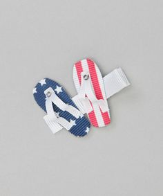 This festive clip works double duty keeping tiny tresses tamed throughout the day's activities while adding a touch of patriotic pride. 1.75'' widePolyester / metalImported