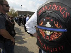 Members of the Warthogs Motorcycle Club wear their