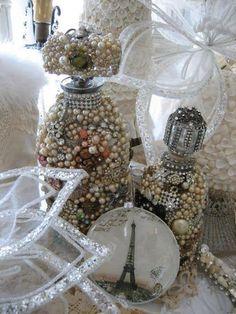decorated vintage bottles with vintage jewels