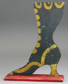 """vintage """"LADIES SHOE COUNTER"""" SIGN Wood boot on base, painted in black with gold buttons and trim, mounted on red base, very early example. Antique Signs, Vintage Signs, Shoe Cobbler, Witch Shoes, Old Boots, Vintage Mannequin, Creative Gifts, Fall Crafts, Vintage Advertisements"""