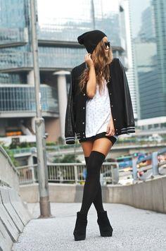 Beanie. Black letterman. White top. Shorts. Over the knee socks.