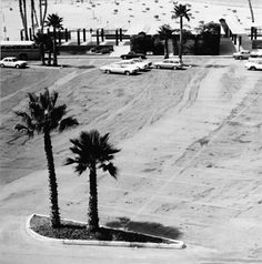 Joe Deal's photographs from his Beach Cities Series are a description of the order of man's incursion and inclusion in the landscape. Sparsely peopled, the views are about structure and humankind's conceptual and physical relationship to it. The non judgmental topographical view of this often geometric societal construct reveals the nature of humankind and often details the intent of the species. (via Ocean View:)