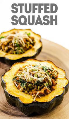 Stuffed Acorn Squash made with lentils, kale, tempeh sausage, and pepitas. #squash #recipes #vegan #holidays #thanksgiving