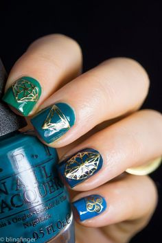 Blue and green ombre nails with geometric gold foil stickers in faceted diamond and angled shapes. #nailart Source