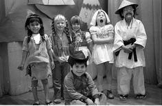 Hubbard Street Elementary kindergarten students participating in an ethnic awareness program, 1977. Sitting: Jerry Ruiz. Also pictured (l-r): Eddie Ramirez, Jennifer Alexander, Nissa Sundberg, Karith O'Keefe, Jason Lopez.. Robert and Betty Franklin Collection. San Fernando Valley History Digital Library.