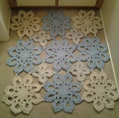 "Another whimsical crocheted rug for my bathroom. Crocheted with ""p"" hook and 3 strands worsted weight acyclic held together in natural & blue colors. Lindsey Edwards Granny Chic Crochet & Sundries"