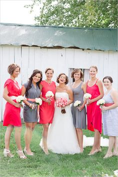 gray and red bridesmaid dresses. love the idea of having two different colored bridesmaid dresses but incorporating them in everyone's dresses