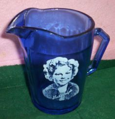 Shirley Temple Atlas Cobalt blue pitcher can be found at Country Roads Emporium in Thorndale Texas.