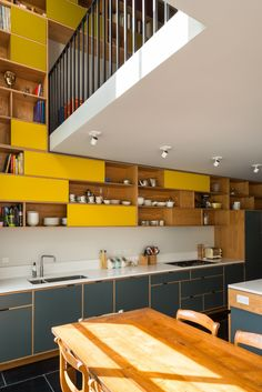 Stunning modern Formica® Laminate kitchen with a white backsplash - wood shelving - tile flooring.