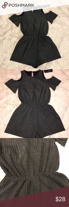 Cold Shoulders Metallic Romper Black and shilver Romper with cute buttons closer at the back. Fits like size 4. Really sexy and unique romper with open back. I wish I could fit it but unfortunately it's not my size. Fits true to size. Please message me for more descriptions if you're interested! #romper #plaid #cute #sexy #velvet #coduroy #tweed #openback #green #red #chic #christmas #lovely #girly #unique #gorgeous #shorts #vintage #retro one clothing Pants Jumpsuits & Rompers