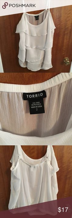 Torrid size 2 white sheer tank Has a thin band at the bottom and ruffles on front of shirt with nothing on back. torrid Tops Blouses