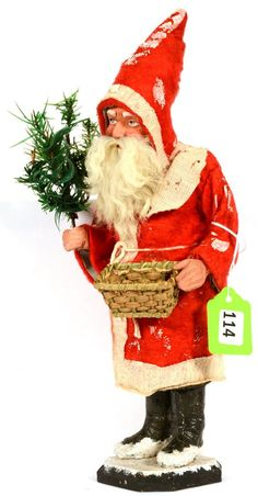 Antique Santa Candy Container....holding tree and carrying a basket.