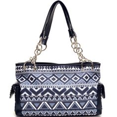 Aztec Purse~etite silver tone studs and chain accented handles make this Aztec Printed bag the perfect trendy addition to your accessory closet! Style never goes out of season and this beautiful bag is one reason why. Flat bottomed for easy stand up, and with a host of storage features to keep all of your much needed items withing reach, you can have the perfect combination of functional and trendy all in one perfectly sized package for everyday wear.