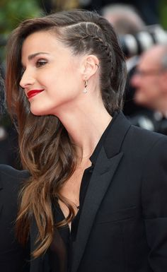 Celine Bosquet in one-side #braid and free natural curls on the other-side #hairstyle during #Cannes2014