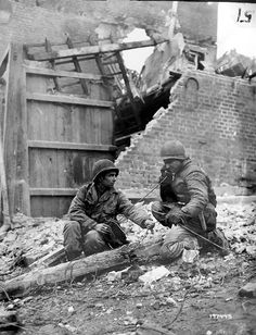 American GIs monitoring the German radio they captured, December 4, 1944