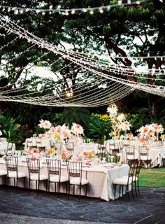 Light the Night - a canopy of lights at an outdoor wedding reception. Image via Style Me Pretty.