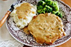 Slow Cooker Smothered Pork Chops are so yummy and tender and the gravy it makes is lip-smacking good. One of my family's absolute favorites!